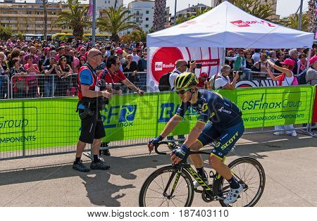 Alghero Italy - May 05 2017: Christopher Juul Jensen passing by the crowd on 100th Giro d'Italia opening day