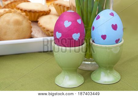 Easter composition - painted eggs and traditional pastry
