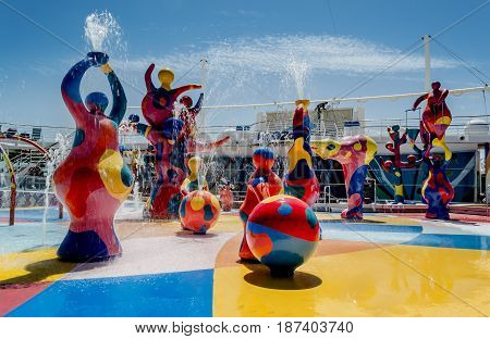 H2O Zone Freedom of the Seas Royal Caribbean International - Barcelona Spain - 07 May 2017: Colorful fountains of a waterpark for kids on a cruise ship.