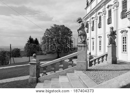 stairs and bannister with statues at the basilica in Olomouc, Czech Republic in black and white