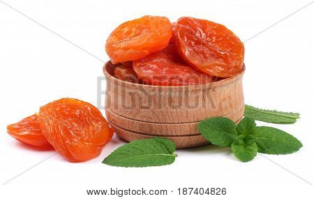 dried apricot in wooden bowl isolated on white background