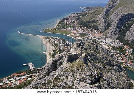 Aerial view - Omis city in Croatia. between Adriatic sea mountain Omiska Dinara and river Cetina