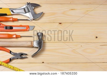 industrial tools on light wooden background with copy space. top view. tools texture. tools background