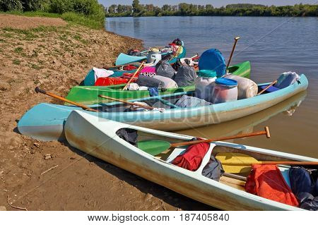 Touring canoes on the shore