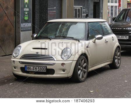 Off White Mini Cooper Car Parked In Hamburg