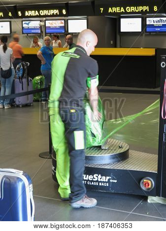 Luggage Wrapping With Plastic Sheet