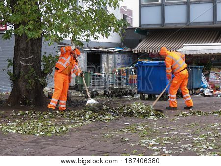 Waste Collectors Collecting Leaves In Hamburg