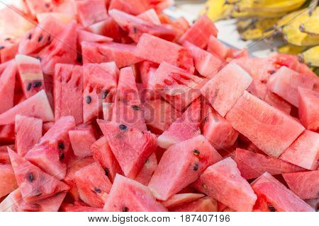 Watermelon sliced on a tray. Watermelon sliced on a tray.