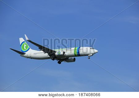 Amsterdam the Netherlands - July 21st 2016: PH-HSF Transavia Boeing 737 approaching Polderbaan runway at Schiphol Amsterdam Airport arriving from Girona Spain