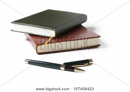 White notebook paper brown and black with pen on white background.