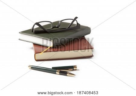 Fountain pen notebook and glasses on a white background.office supplies