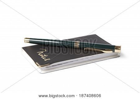White notebook paper black with pen on white background.office supplies