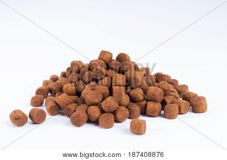 Dry dog food granules isolated on white background