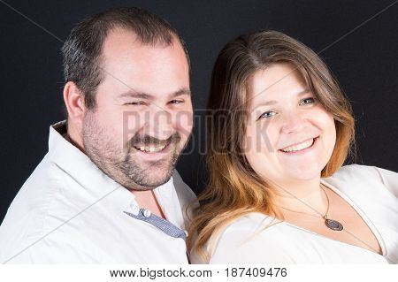 a cheerful smiling thirty year old couple
