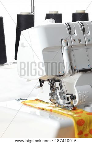 Overlock sewing machine - view on working area and thread cones