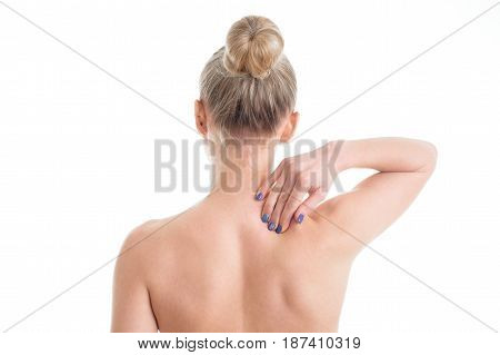 young female nude with neckache touching her neck. Isolated on white