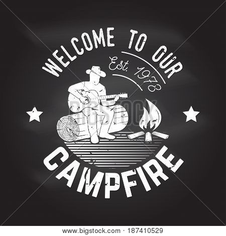 Welcome to our campfire. Vector illustration on the chalkboard. Concept for shirt or logo, print, stamp or tee. Vintage typography design with Camper tent and forest silhouette.
