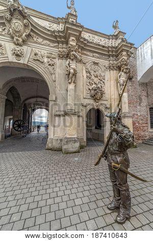ALBA IULIA Romania - APRIL 30 2017: Bronze statue with soldier in front of Third Gate of the City in Citadel of Alba Iulia city.