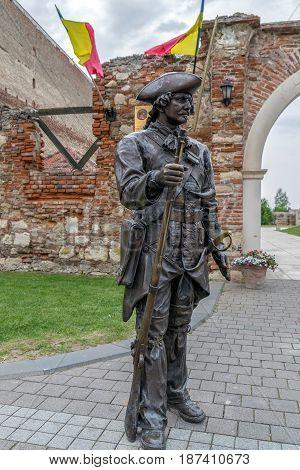 ALBA IULIA Romania - APRIL 29 2017: Bronze statue with soldier in front of one Gate of the City in Citadel of Alba Iulia city.