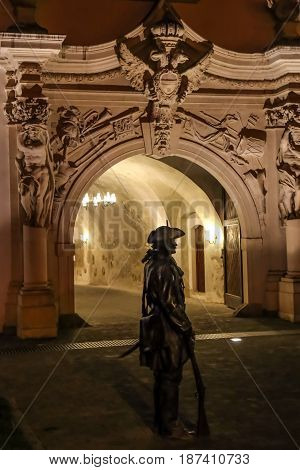 ALBA IULIA Romania - APRIL 29 2017: Night scene with bronze statue of one soldier in front of one Gate of the City in Citadel of Alba Iulia city.
