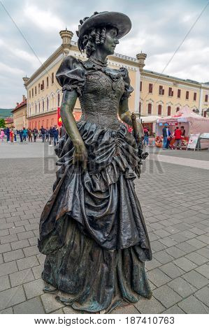 ALBA IULIA ROMANIA - APRIL 29 2017: Bronze statue with one Lady in Alba Carolina Citadel square depicting a medieval dressed and representing scenes of city life.
