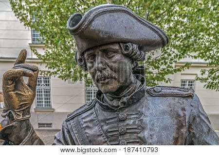 ALBA IULIA ROMANIA - APRIL 29 2017: Bronze statue with portrait of one gentleman in Alba Carolina Citadel square depicting a medieval dressed and representing scenes of city life.