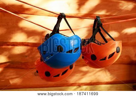 the several mountaineering helmets suspended on a rope