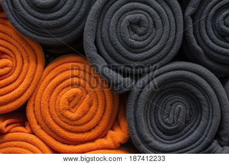 Blue and orange towels are on the shelves