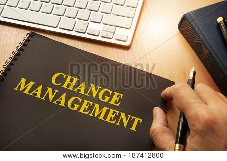 Book with change management on a table.