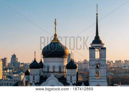 Towers and domes of Annunciation Cathedral in sunset, Evening Voronezh cityscape
