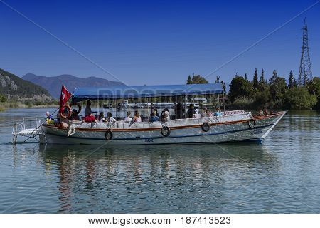 TURKEY, MUGLA ,DALYAN, - 5 MAY , 2017: The Dalyan River with tourist boats in the straits of the river