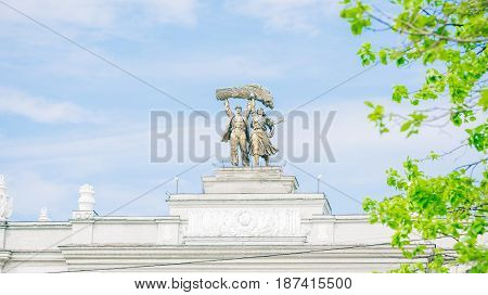 Figures on top of main entrance arch at VDNKh - Exhibition of Achievements of National Economy
