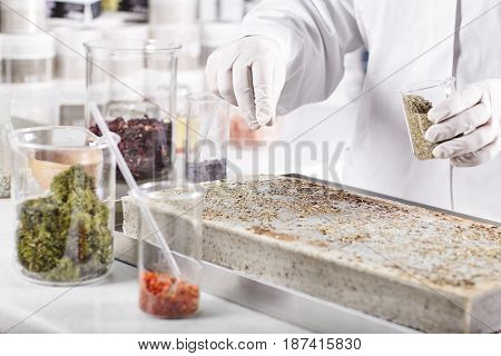 Research Worker In Laboratory Standing Against Laboratory Background Surrounded With Glass Beakers F