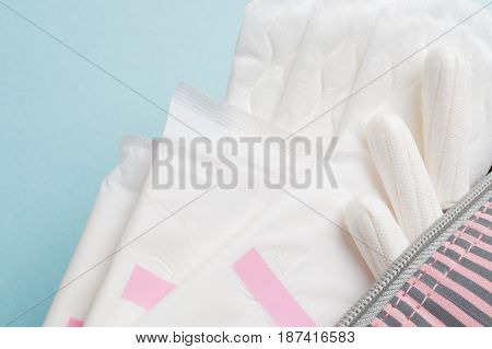 Menstrual Tampons And Pads In Cosmetic Bag. Menstruation Cycle. Hygiene And Protection