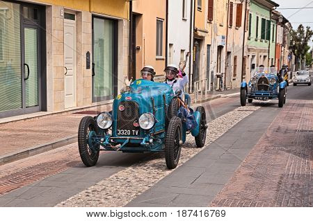 GATTEO, FC, ITALY - MAY 19: the female crew S. Marini S. Stoeckelmann on an old Bugatti type 23 (1920) in historical classic car race Mille Miglia on May 19, 2017 in Gatteo, FC, Italy