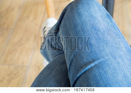Blue new jean wearing by women legs modern clean selective focus with space