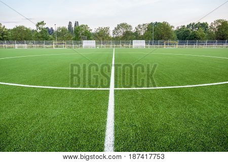 An football field with artificial turf and white lines