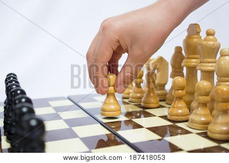 The chess pieces are placed on the chessboard. Chess. First step