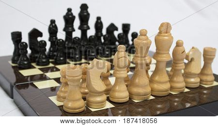 The chess pieces are placed on the chessboard. Chess