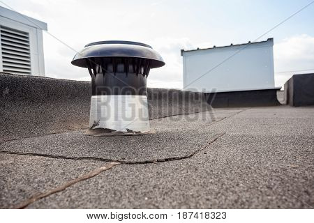 ventilators on the roof of a tall building in the industrial area