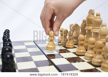 The chess pieces are placed on the chessboard. First step. Chess. Beginning of the game.