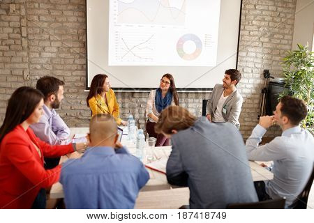 Company employees on business meeting indoor