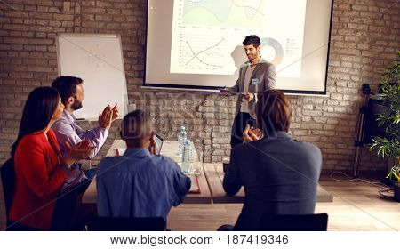 Male holding business presentation about success in business