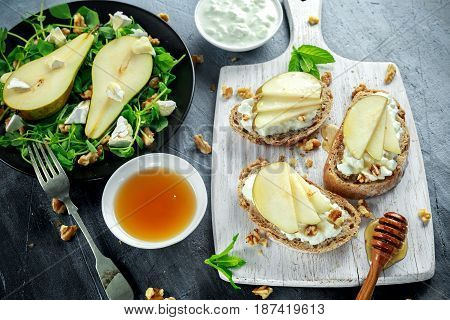 Fresh sweet Pears salad and bruschetta with cottage cheese, walnut on white board