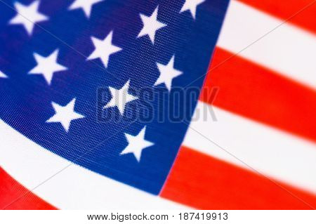 USA small flag background close-up. Star-striated american banner