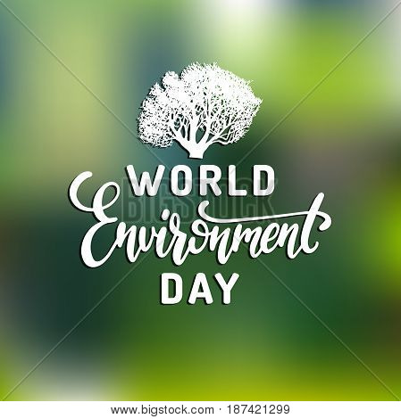 World environment day hand lettering for cards, posters etc. Vector calligraphy with tree illustration on blurred green background.