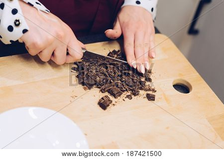 Cafe Employee Cuts The Chocolate Into Small Pieces.