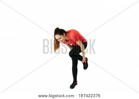 A pretty girl was injured while playing sports. white background.