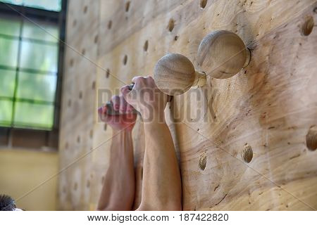 Climber Man Climbing On Practice Wall