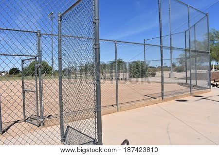 A picture of a baseball diamond at a park in the desert.